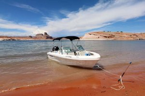 19' Open-bow Ski Boat anchored on shore of Lake Powell
