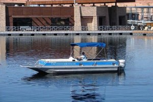 man driving 26' deck cruiser on Lake Powell