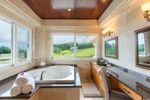 A jetted tub with a view of a golf course