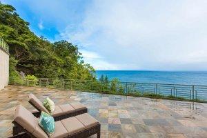 A balcony near a rainforest and the ocean