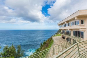Waterfalling estate on a steep coast above the ocean