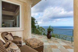 Chairs on a balcony near the ocean