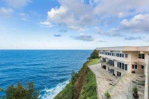 Waterfalling estate atop a steep coastline