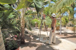 Villa del Faro man painting outside