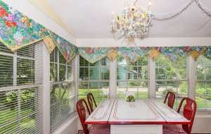 Grape Arbor Sun Room Dining Area