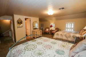 the bed in the upstairs bedroom