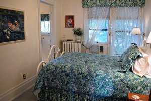 bedroom with white cast iron bed