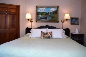 guest room with impressionist painting