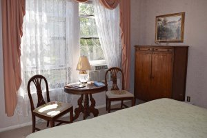 bedroom with antique table and chairs