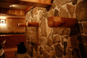 shelves and stone wall