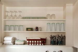 shelves with dishes and towels