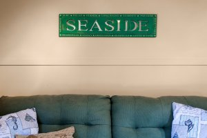 Seaside sign above couch