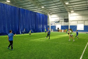 Shooters Soccer Club Facility advertisements on wall kids practicing