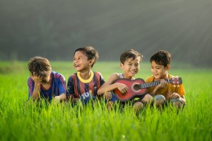 Shooters Soccer Club Facility Events kids in grass with ukulele