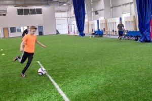 Shooters Soccer Club Facility boy kicking soccer ball