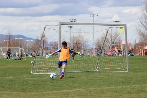 Shooters Soccer Club Facility goalie kicking soccer ball