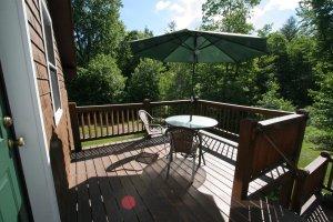 Old Saco Inn Emma's Loft exterior deck table chairs umbrella