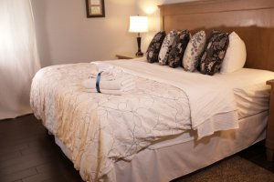 MySpine Mattress made up bed angled view with towels