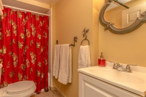 Bathroom with red curtains