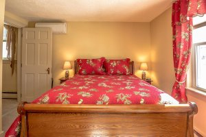 A bed with red covers