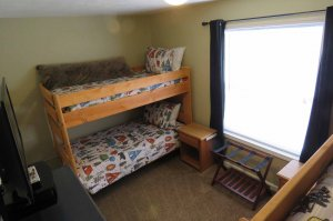 Two bunk beds in a room