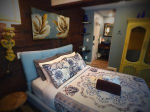 Pillows by headboard on bed