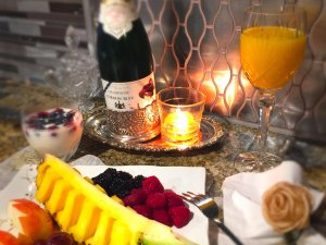Fruit plate with orange juice and champaigne