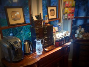 Snack bar with coffee maker and water pitcher