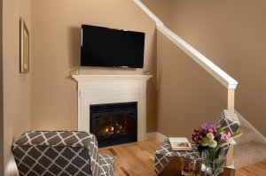 tv on top of fireplace