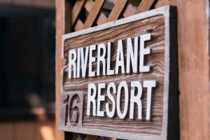 Sign reading Riverlane Resort 16
