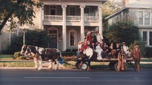 Murder Mysteries group outside house with horse drawn carriage