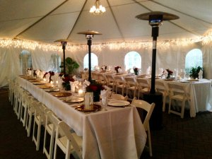 tables under tent radiant heaters