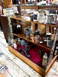 antique mugs on shelves