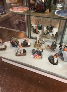 figurines in display case