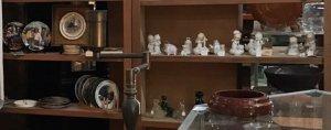 antique figurines on shelves