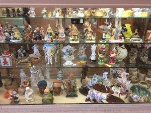 antque figurines on shelves