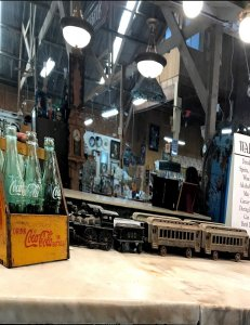 Coca Cola bottles and model train