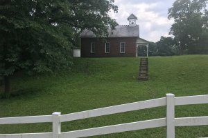 church on grassy hill
