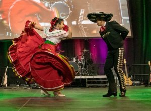 A couple performing a latin dance
