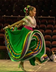 A woman doing a traditional latin dance