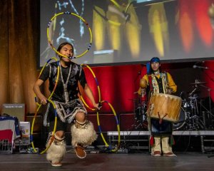 A native American drummer and dancer on stage