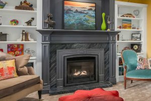stone fireplace and painting