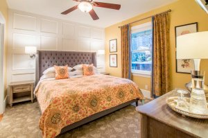 king bed and ceiling fan