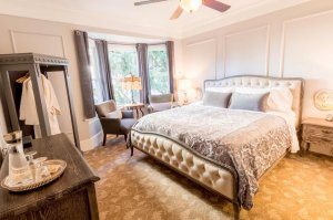 fancy bed with throw pillows and headboard