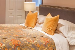 bed with yellow pillows