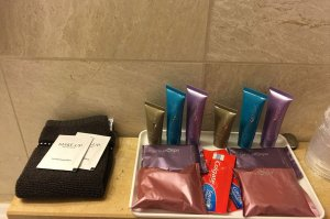 face towels, soap, toothpaste, and shampoo and conditioner