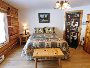 log cabin furniture with quilt