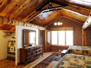 queen beds in large cabin theme room