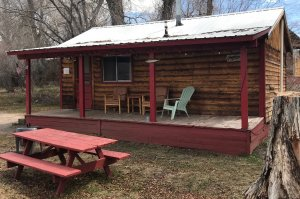 red trim cabin and picnic table