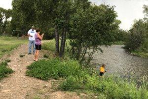 Girl fishing on riverbank